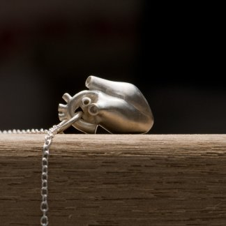 Solid silver anatomical heart 'killer charm' pendant, on a fine silver chain necklace. Made by William White
