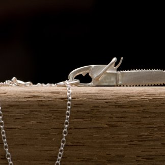 Silver chainsaw 'killer charm' pendent on a fine silver chain necklac by William White