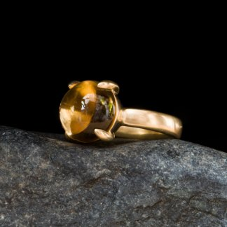large yellow citrine cabochon claw set in gold ring