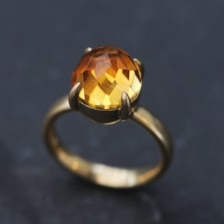 Large rose cut citrine cabochon claw set in gold ring
