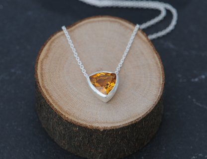Simple Citrine trillion pendant in satin finished sterling silver. Available with 16″ or 18″ chain. Designed and handmade by William White in Cornwall, UK