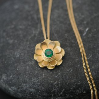 Beautiful emerald daisy pendant necklace, set in 18k gold. This gold and emerald necklace is designed and handmade by William White in Cornwall, UK.