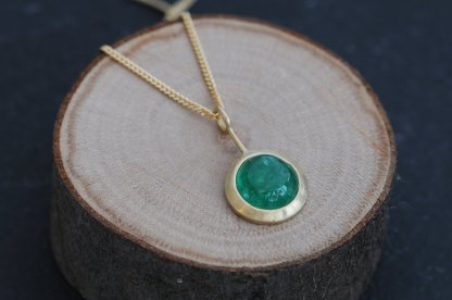 Beautiful emerald cabochon lollipop pendant necklace, set in 18k gold on a gold chain. Designed and handmade in Cornwall, UK by William White