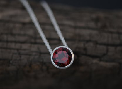 Deep red garnet necklace in satin finished sterling silver on silver chain. Made by William White