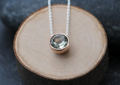 Lovely pale green amethyst, set in a satin finished 9K rose gold pendant on a silver chain. Designed and handmade by William White in Cornwall, UK