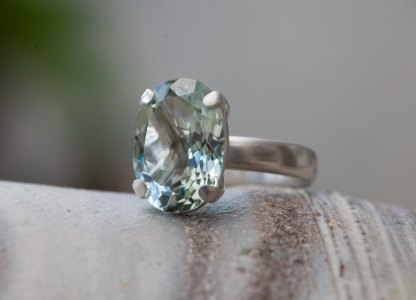 pale green amethyst solitaire claw set in sterling silver ring