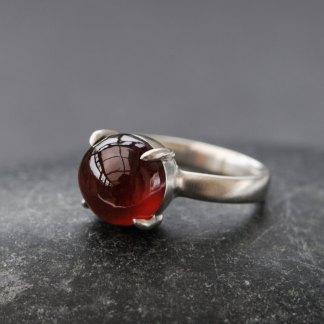 Hessonite garnet claw set in sterling silver ring