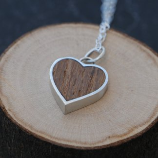 Silver heart set with wood from HMS Victory - Nelson's ship at the Battle of Trafalgar. On a silver chain. Designed & handmade by William White in Cornwall