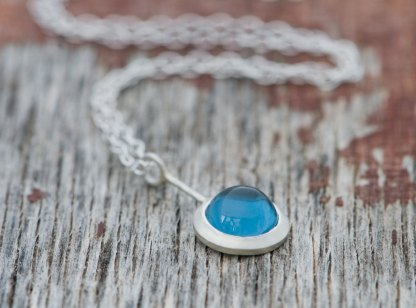Simple London blue topaz cabochon Lollipop necklace, set in sterling silver. Choice of chain length. Designed and handmade by William White in Cornwall, UK