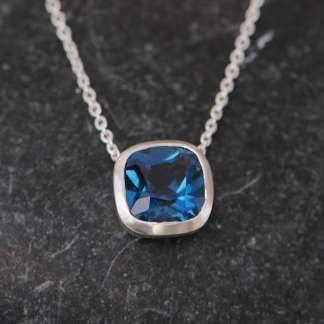 Cushion cut pendant with London Blue Topaz square stone set in silver on sterling silver chain.
