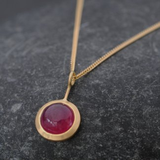 Beautiful Ruby 'Lollipop' necklace, set in 18k Yellow Gold. Fracture filled ruby cabochon is 8mm across and 3 carats by William White