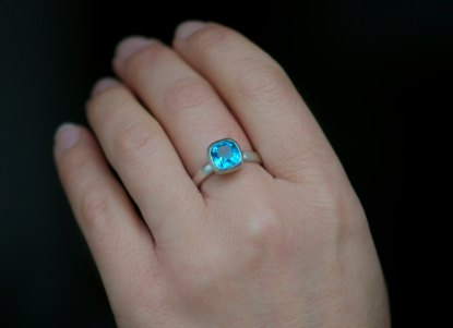 Bright Swiss Blue Topaz stone in silver ring