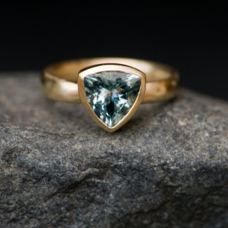 Aquamarine trillion ring in yellow gold