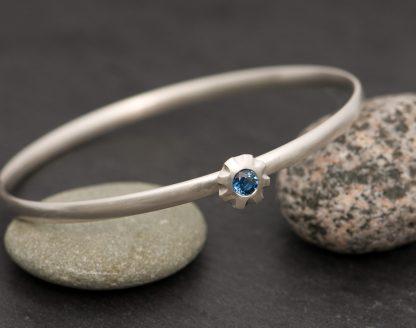 blue sapphire bangle in silver