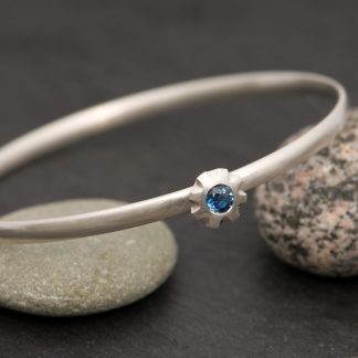 blue sapphire bangle in silver