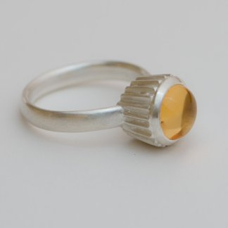 Silver ring with quirky citrine cupcake design.