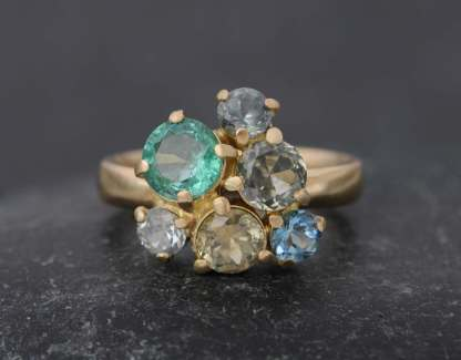 Beautiful emerald and sapphire cluster ring in gold
