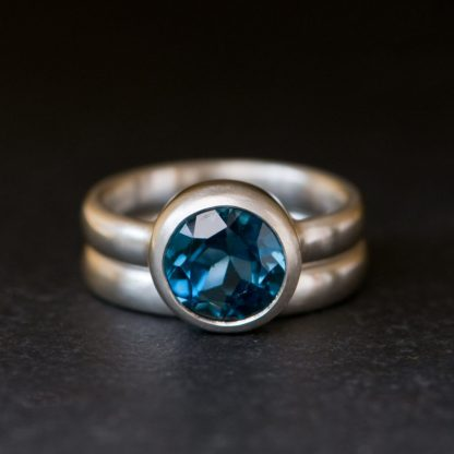 London Blue Topaz solitaire stone set in silver ring and wedding band