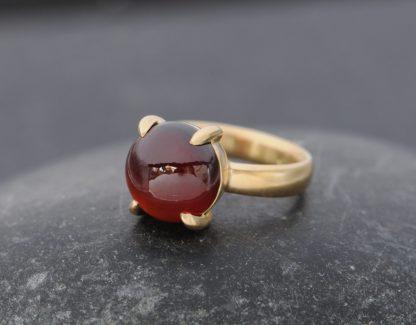 red garnet cab 12mm dragonseye ring in 18K