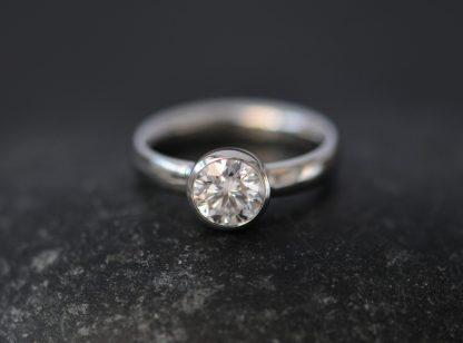 moissanite 6mm round bezel set in platinum
