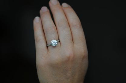 Moissanite 7mm halo ring in platinum