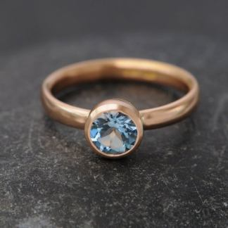 aquamarine AAAA 7mm bezel set in 18K r gold