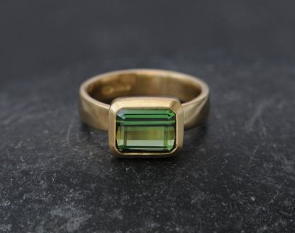 green tourmaline ring set in satin finished 18k yellow gold.