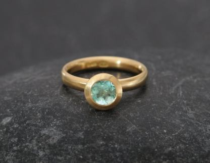 emerald 6mm halo ring in 18K yellow gold