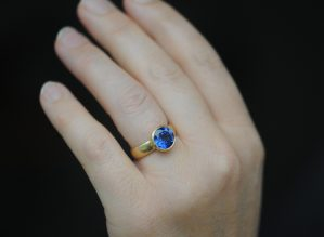 lab created 9mm blue sapphire in 18K yellow gold