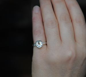 white topaz heart ring on hand