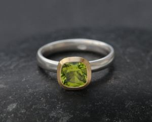 peridot 7mm cushion halo ring in 18K gold and silver band