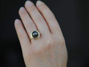 black pearl halo ring 18K yellow gold