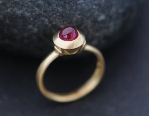 Beautiful Cabochon Ruby Ring set in satin finished 18K Gold. This ring is based on a medieval ring design, held in London's Victoria and Albert Museum. Natural Cabochon Ruby, wonderful deep pink colour. Untreated Cabochon Ruby is 5.5mm diameter and 1 carat This ring is made to order