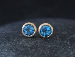 london blue topaz 7mm round stud earrings 18K y gold