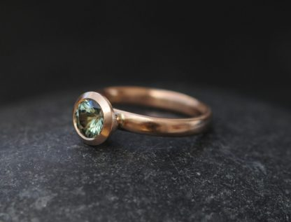 green sapphire 6.5mm halo set in 18K rose gold