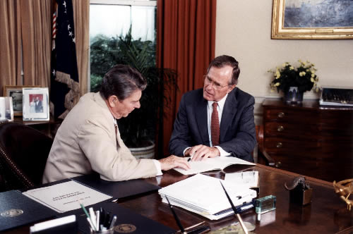 Reagan and Puppet Master daddy Bush, former director of the CIA