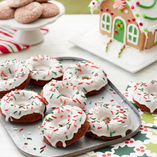 festive gingerbread donuts with white icing and red and green sprinkles