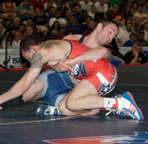 Kellen Russell (back), a two-time NCAA champion from Michigan, defeated Oklahoma State's two-time titlist Jordan Oliver for the 2013 U.S. Open title at 145.5 pounds.