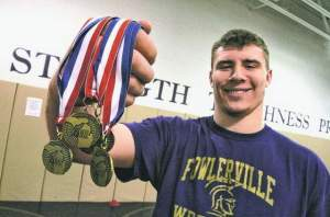 Fowlerville heavyweight Adam Coon, won four Michigan state championships, will now take on Big Ten's big men once he joins the Wolverines.