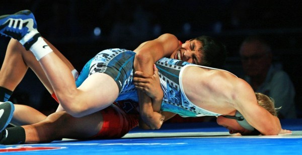 Zahid Valencia (top) of California lost his first Greco bout in the Cadet tournament, but came back to win eight matches, including a 12-4 technical fall over Hayden Hidlay of Pennsylvania for the 126-pound championship