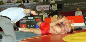J.D. Bergman was leading 3-0 before Alexey Krupnyakov of Kyrgyzstan used a double overhook to take him to his back and score a fall in 3:58. (Bob Mayeri image)