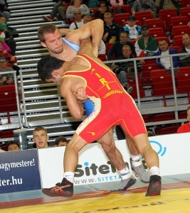 Reece Humphrey (top) could not hold off Iranian Masoud Esmailpourjouybari  after taking a 5-0 lead in his 132-pound quarterfinal match in men's freestyle at the 2013 FILA Worlds.