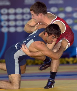 Bryce Saddoris (right) scored a fall in his first Worlds match. (Bob Mayeri image)