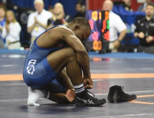 Ryan Mango, a two-time Olympian, left his wrestling shoes on the mat to show that he is retiring from the sport after losing in the 59-kilo semifinal to Jesse Thielke.