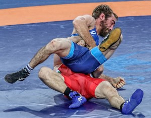 The gut wrench — the same move that helped Daniel Dennis earn an Olympic spot in April — eliminated the former Iowa Hawkeye when Vladimir Dubov of Bulgaria used the move to score four straight turns in an 11-0 first round victory over Dennis. (John Sachs photo)