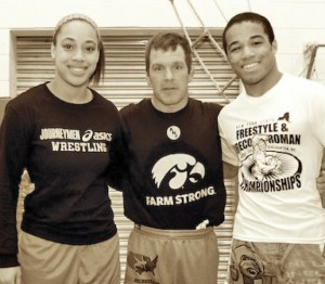 Iowa coach Terry Brands (center) worked with siblings Alexis and Jesse Porter, who started competing in the Journeyman Mini-Men Club when they were eight years old.