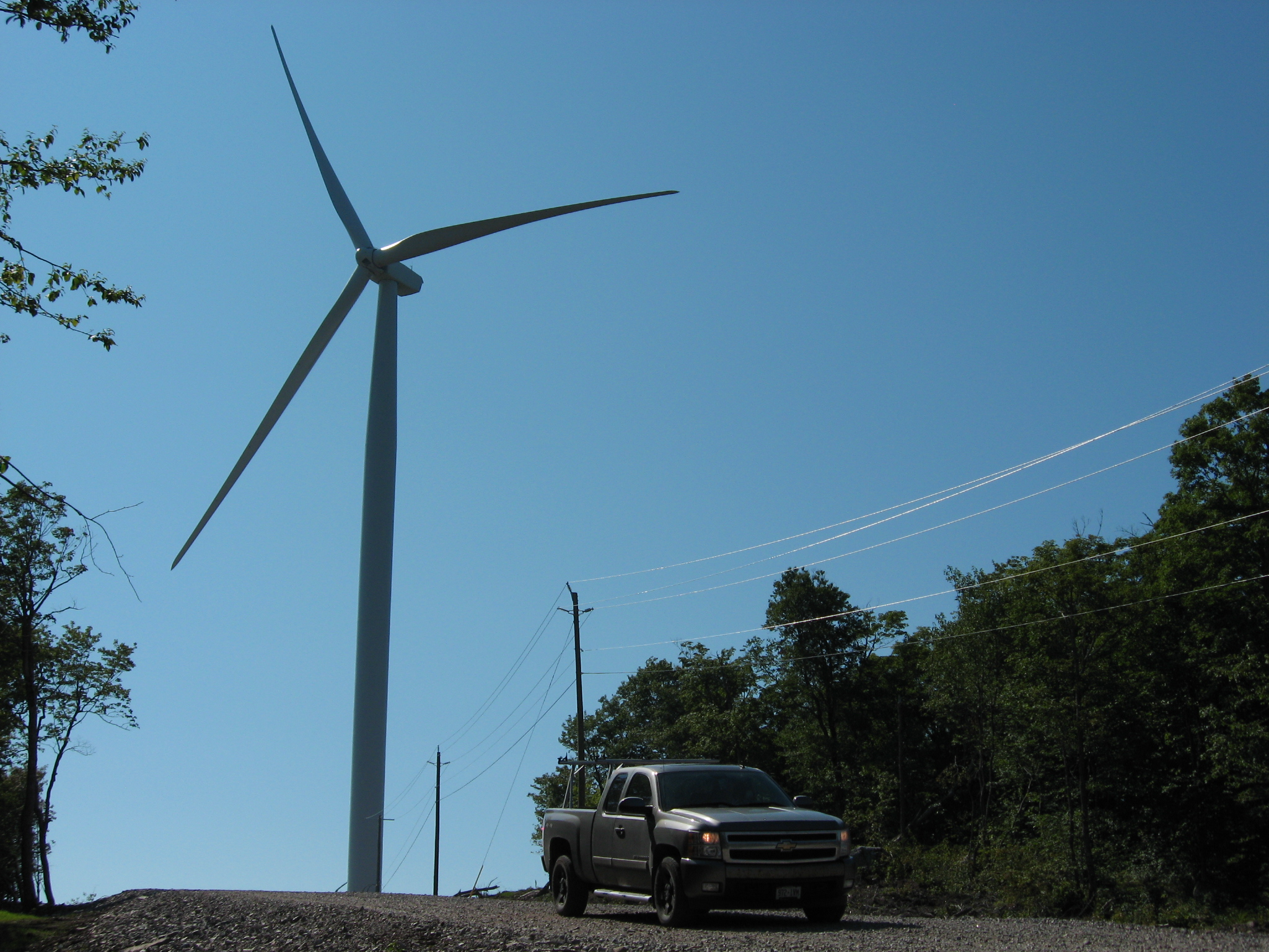 Huge turbines dwarf the landscape; here, a truck travels over a new road built for the power project in Algoma