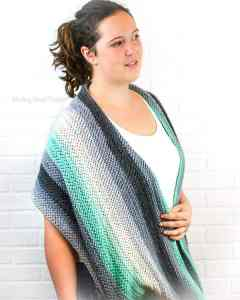 The Herringbone Infintiy Shawl is a great crochet shawl to carry with you. This free crochet pattern is great for beginners that are ready to try a new stitch. I have a herringbone crochet stitch photo tutorial. The texture in this shawl is very unique and the shawl can be worn like a thick infinity scarf. #crochet #crochetpattern #forbeginners #easy #shawl #crochetshawl #infinityscarf