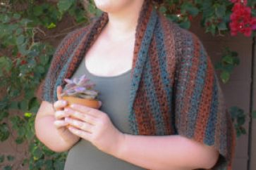 Free crochet pattern. Winter Shrug to keep you warm and works well with striping yarns.