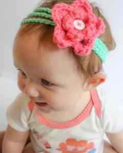 Rosey's headband is a free crochet pattern for a baby through girl's size headband. We waited a lifetime to be able to dress up our little girl's on flowers and bows and now we finally get to. This pattern is designed to be quick and easy and is only limited by the colors in your yarn stash. This project is perfect for accessorizing your baby's outfit or make up a bunch and give them as a baby shower gift. There is instructions for a bow or flower to top this headband. Check out my blog for an easy baby girl dress as well. #free #pattern #headband #babyheadband #diyheadband #diy #crochetheadband #quick #easy #crochetpattern #freepattern #freecrochetpattern #babygirl